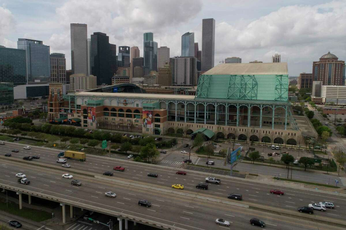 Traffic moves briskly along Interstate 69 near Minute Maid Park on March 13, 2020, in Houston.