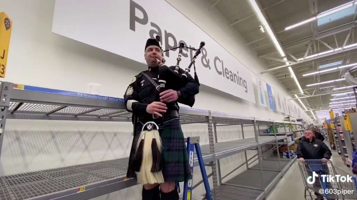 """New Hampshire's Police Association Pipes & Drums play """"Amazing Grace"""" in Walmart after a coronavirus panic left the paper and cleaning goods section empty. The full video, available on TikTok by user @603piper, is one example of communities coming together during the outbreak."""