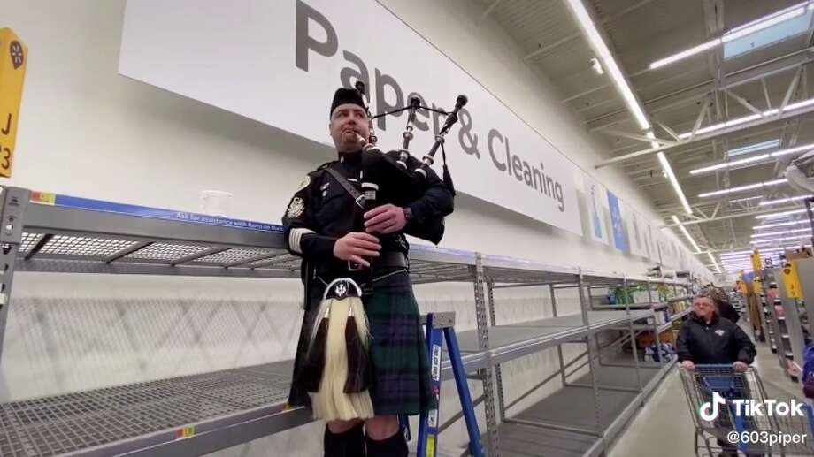 "New Hampshire's Police Association Pipes & Drums play ""Amazing Grace"" in Walmart after a coronavirus panic left the paper and cleaning goods section empty. The full video, available on TikTok by user @603piper, is one example of communities coming together during the outbreak. Photo: Screenshot From TikTok By @603piper"