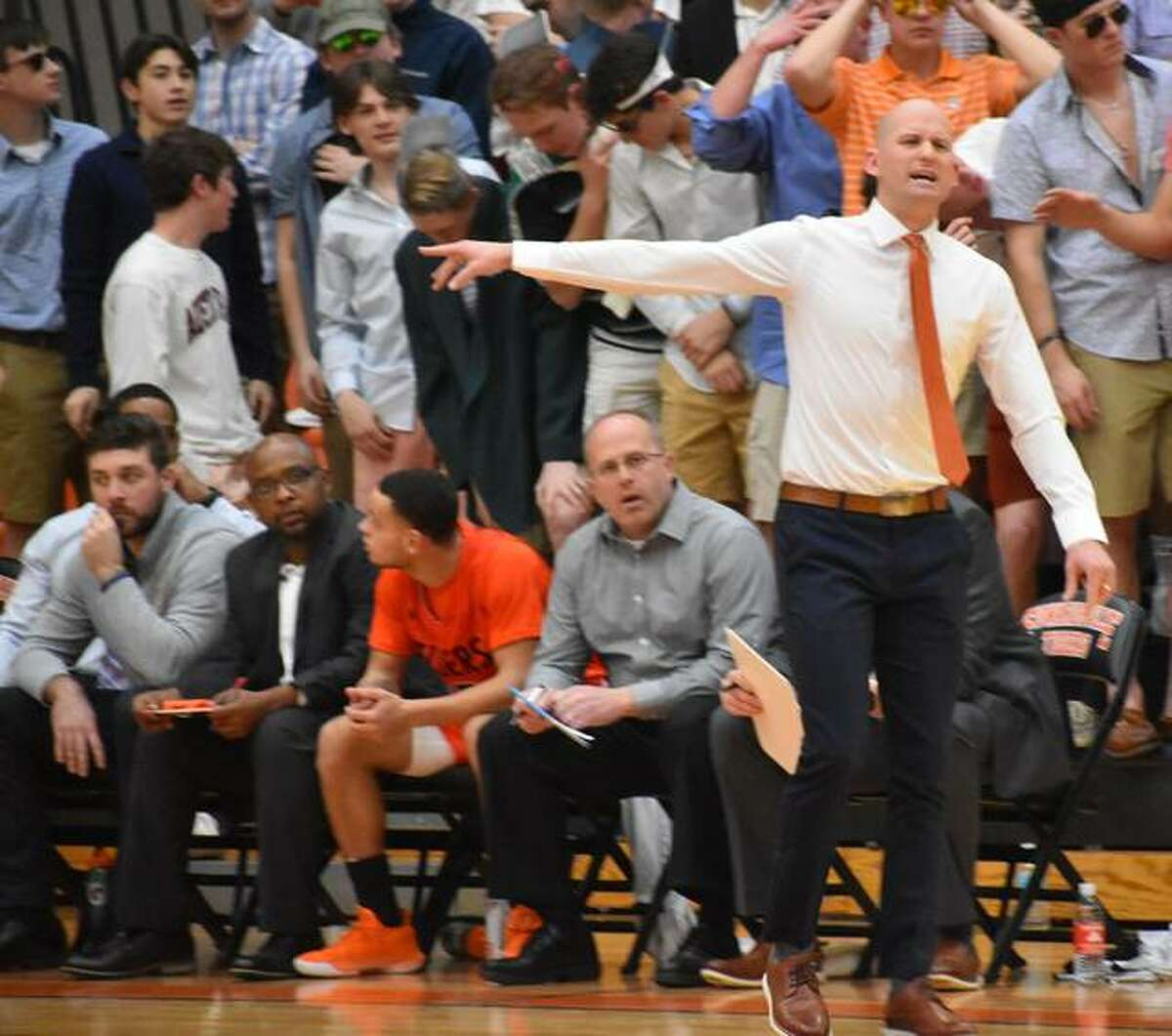 Edwardsville coach Dustin Battas shouts out instructions from the bench during the first half against O'Fallon in the regional championship game.