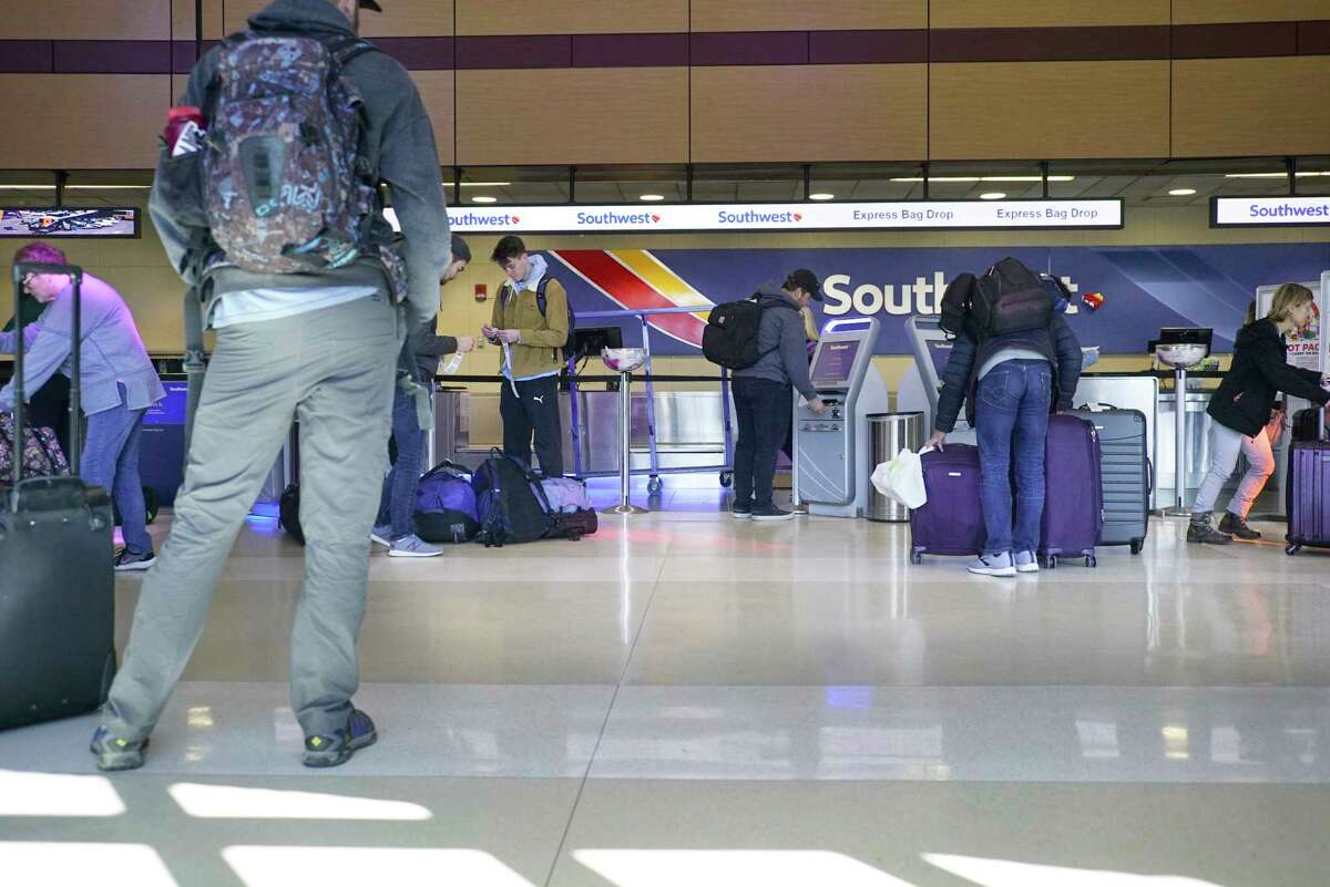 Southwest Airlines passengers go through the check-in process at the Albany International Airport on Sunday, March 15, 2020, in Colonie, N.Y. (Paul Buckowski/Times Union)