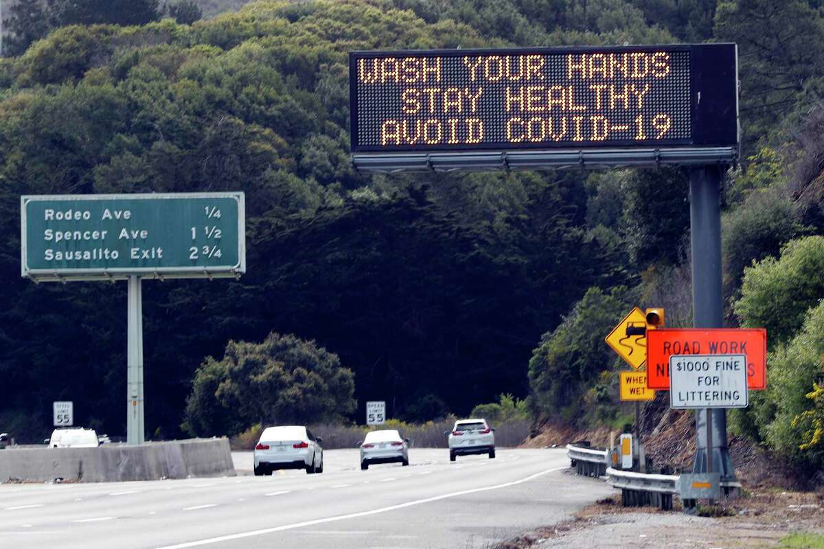 A highway sign on 101 flashes a COVID-19 advisory in Sausalito.