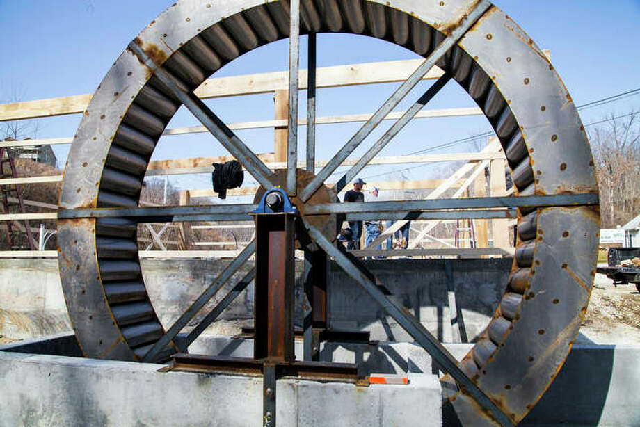 The giant metal water wheel at the site of coming new attraction Cox's Mill, in Grafton, is to be completed this spring . Located on West Main Street, just northwest of the Grafton SkyTour ticketing facility, the mill property will feature an artist shop on a main floor and accommodations for six on a second floor. Photo: Jeanie Stephens| The TelegraphJeanie Stephens| The Telegraph