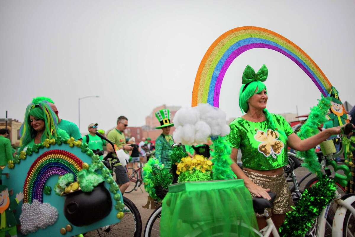 People gather to celebrate St.Patrick's Day early as part of a Galveston tradition on Sunday, March 15, 2020, in Galveston.