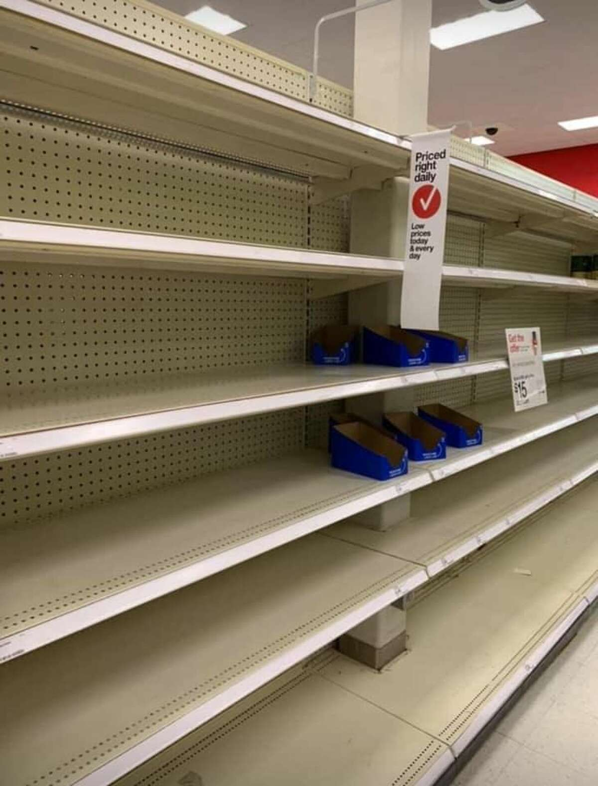 Complete aisles were bare at the Target store in Tukwila, Wash. on March 15, 2020. For a look at some of the empty shelves across the Seattle area, click through the gallery. >>>