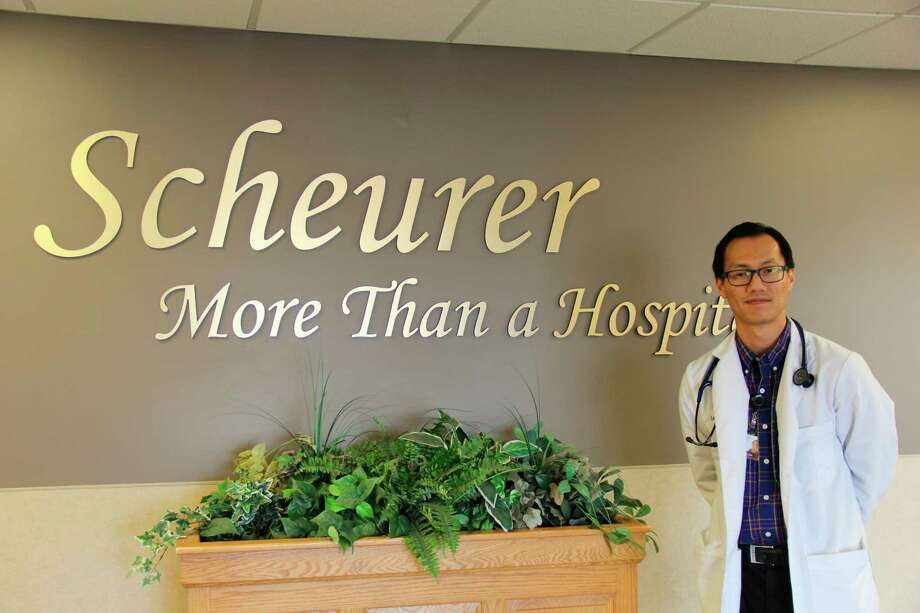 Dr. Long Nguyen outside of his office at Scheurer Hospital. Nguyen immigrated to America with his mother from Vietnam in 1993. (Robert Creenan/Huron Daily Tribune)