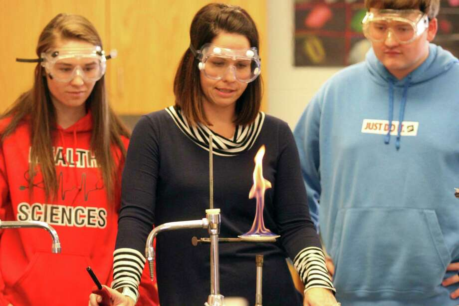 Emily Polega works on a chemistry experiment with her class at North Huron. (Eric Rutter/Huron Daily Tribune)