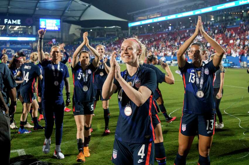 U.S. defender Becky Sauerbrunn (4), forward Lynn Williams (13) and teammates acknowledge fans after a 3-1 win over Japan in a SheBelieves Cup soccer match Wednesday, March 11, 2020, in Frisco, Texas. (AP Photo/Jeffrey McWhorter)