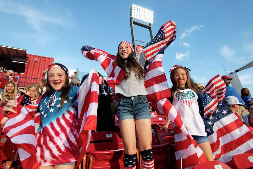 Willow Stone, 8, Chloe Stone, 10, and Hannah Walker, 10, cheer before a SheBelieves Cup women's soccer match between the United States and Japan, Wednesday, March 11, 2020 at Toyota Stadium in Frisco, Texas. (AP Photo/Jeffrey McWhorter)