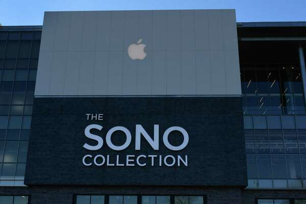 Local businesses like the Apple store in the SoNo Collection mall cope with the Covid-19 virus outbreak by either closing or offering incentive Saturday, March 14, 2020, in Norwalk, Conn.