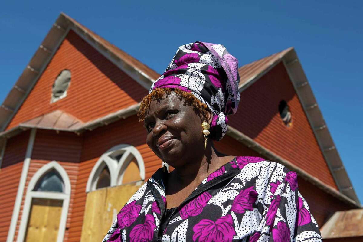 Pastor Shetigho Nakpodia, 67, stands outside her newly painted Redeemer's Praise Church on March 6. She has ministered to those in need for the past nine years from the historic East Side building.