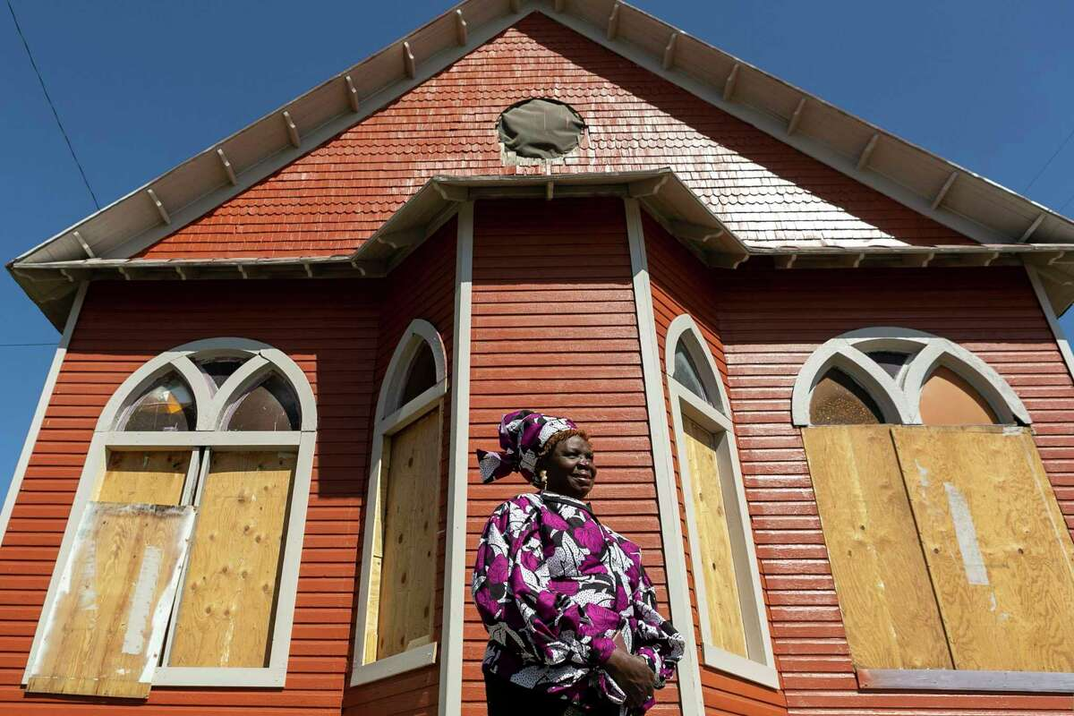 """Pastor Shetigho Agbuke, 67, poses at Redeemer's Praise Church in San Antonio, Texas, on March 6, 2020. Agbuke has ministered to those in need for the past nine years at the East Side building. """"Everything I did, I was always taking care of people,"""" says Agbuke of her life before becoming an ordained minister in 1994. """"I know that God called me to do this,"""" she went onto say. """"When I stepped into my calling everything fell into place. Once you take the calling- the help comes,"""" Agbuke says. """"Our time is so short... What you can do to make your corner of the world wonderful- do your part."""""""