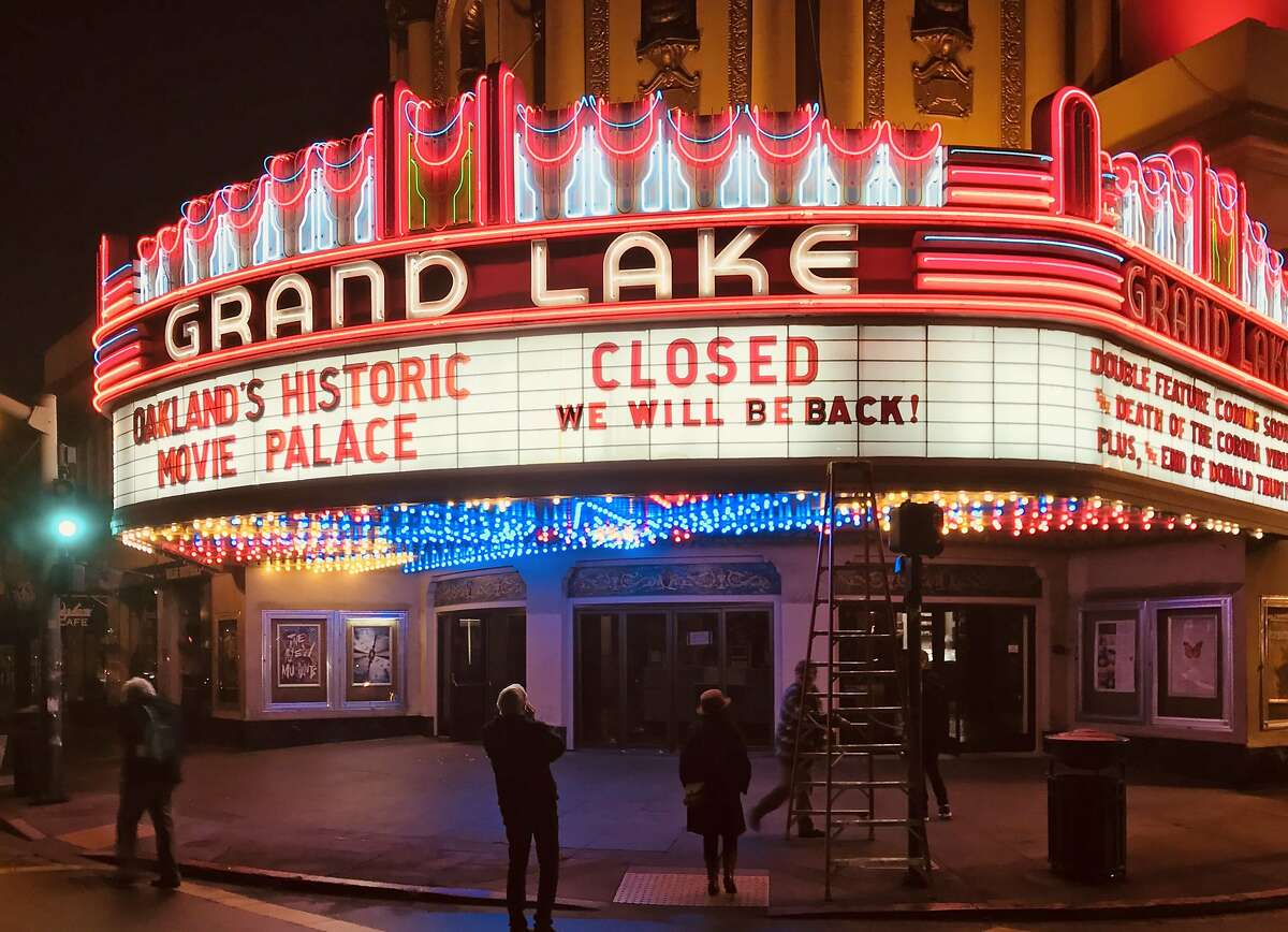 The Grand Lake Theatre changed its marquee to announce its closure on Sunday, March 15, 2020.