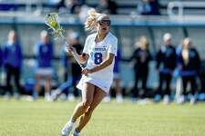 Darien's Katie Cronin (18) in action during the Duke women's lacrosse team's game against Virginia in Durham, N.C., on Saturday, March 7, 2020.