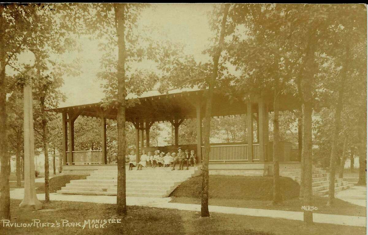 This group of children gather under the pavilion at Reitz Park in this photo from the 1920s.