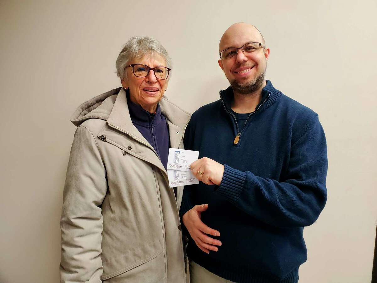 Erika Kaiser, of Manistee, was the grand prize bingo winner. Kaiser (left) won a $150 gift card to the Vogue Theatre and she is pictured with the News Advocate'scirculation director, Aaron Dekuiper.