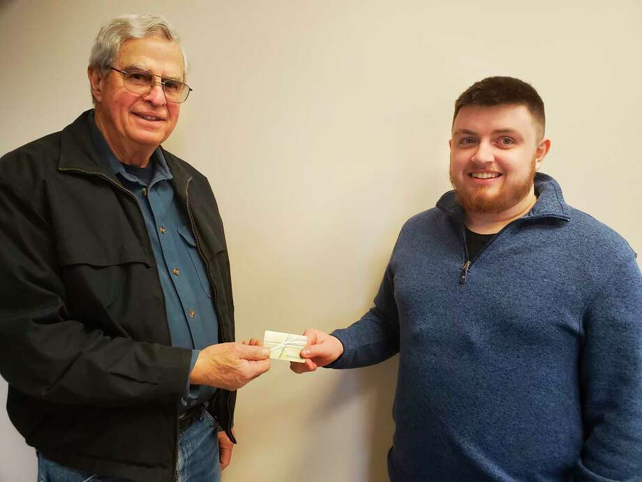 Kenneth Soller (left)won a $50 gift card to Family Farm and Home in Manistee after he played the Manistee News Advocate bingo contest. Kyle Ray, inside sales and territory management representative fron the News Advocate, is pictured presenting the gift card. (News Advocate photo)