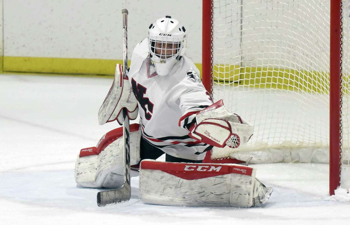 New Canaan goalie Blythe Novick makes a glove save during the Rams' girls ice hockey game against Darien at the Darien Ice House on Saturday, Jan. 4, 2020.