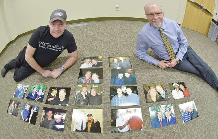 Mark Medley (left) and Kevin Eckhoff show a few of the thousands of celebrity photos they have taken over the years. Photo: David Blanchette | Journal-Courier