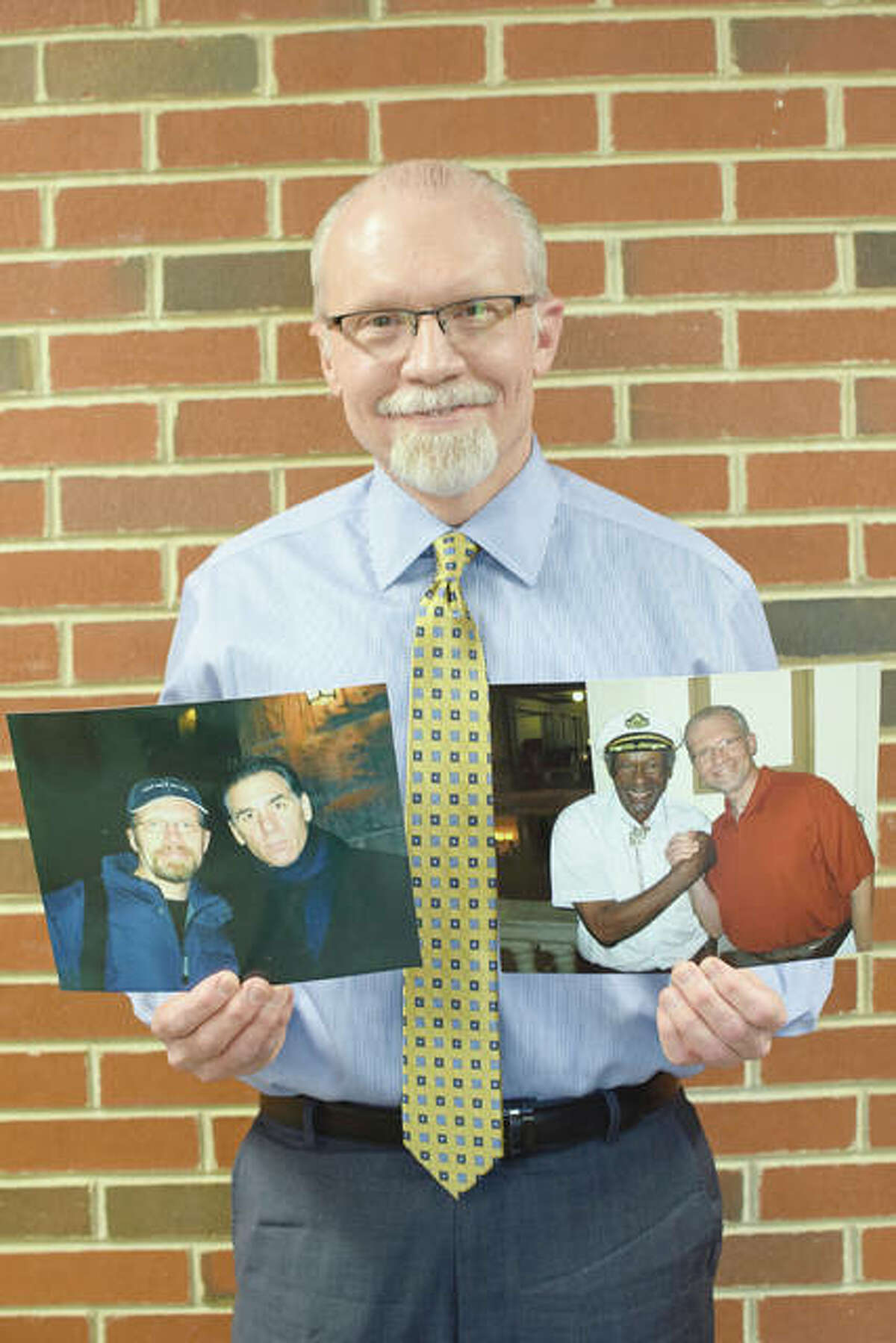 Kevin Eckhoff displays photos he had taken with comedian Michael Richards and musician Chuck Berry.