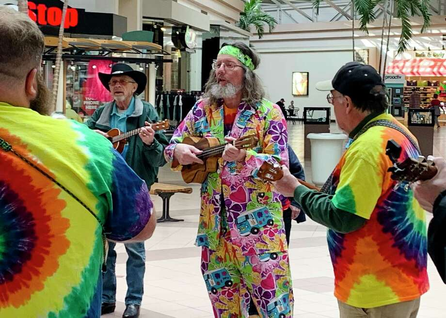 """The sixth annual """"Winter Ain't Stoppin' Serious Uke Players"""" (WASSUP!) festival was kicked off Friday afternoon with a """"ukulele flash mob"""" at the Midland Mall, where performers filled the building with the sounds of tunes such as """"This Little Light of Mine"""" and """"She'll Be Coming Round the Mountain."""" (Mitchell Kukulka/mitchell.kukulka@mdn.net)"""