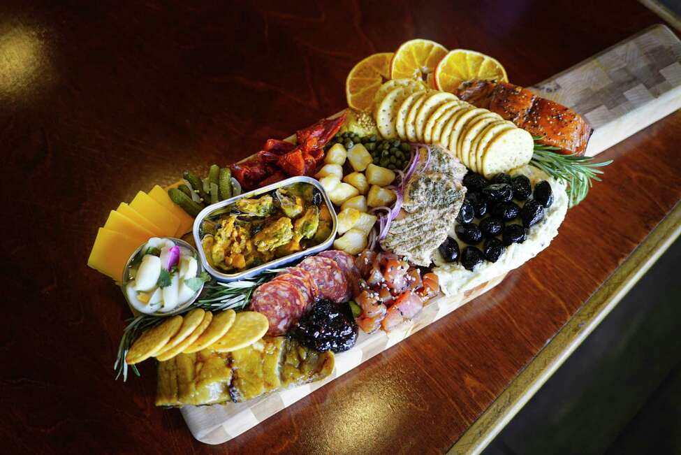 A view of the sea-cuterie board at Fin Your Fishmonger, on Wednesday, March 11, 2020, in Guilderland, N.Y. The board is filled with various types of smoked fish, like smoked pepper salmon, house smoked salmon, smoked bay scallops, and smoked lemon herb mussels. (Paul Buckowski/Times Union)