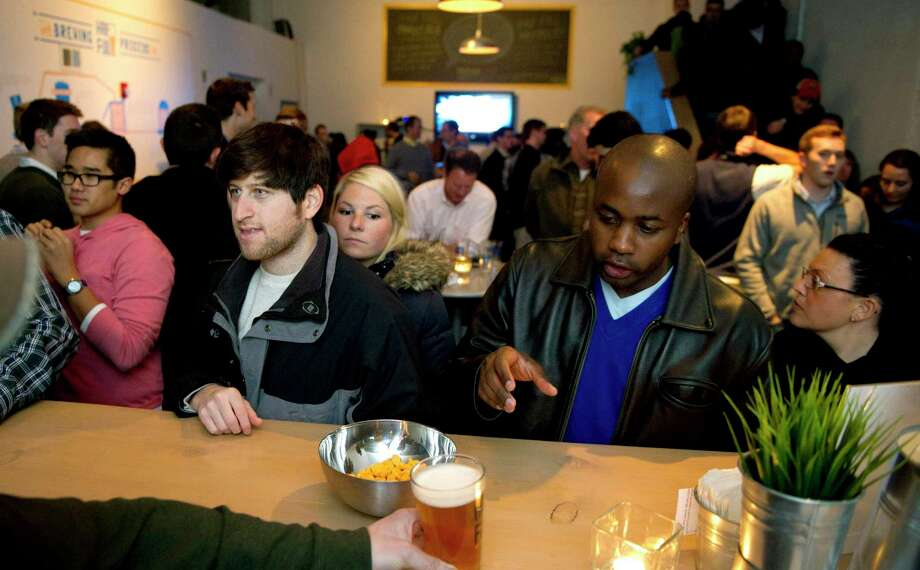 Patrons of a Stamford, Conn. bar that was supplied by Rogo Distributors, whose parent company informed the state Department of Labor in March 2020 of its intent to close at a cost of more than 90 jobs. Photo: Lindsay Perry / Lindsay Perry / Stamford Advocate