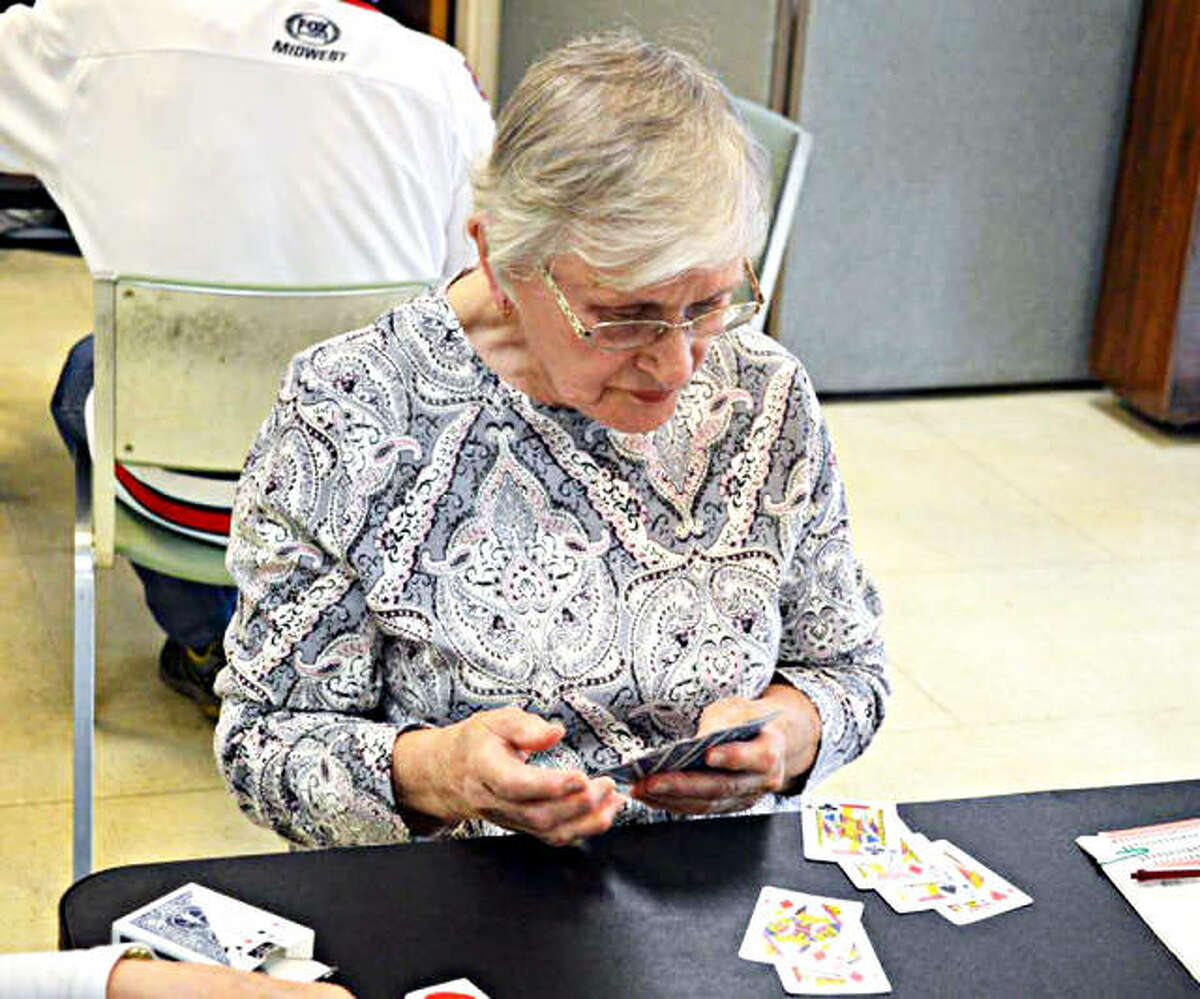 In this April 2019 file photo, Rosemary Moehle, of Edwardsville, plays pinochle at the Main Street Community Center in Edwardsville. The social activity is one of many that have been canceled in an effort to keep citizens safe during the coronavirus outbreak.