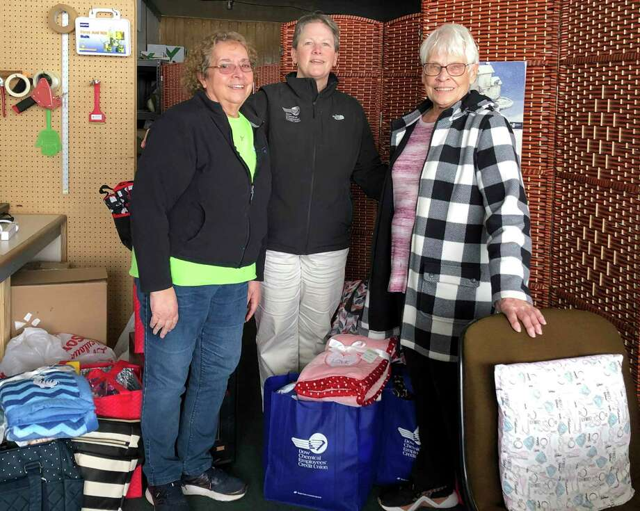 From left, Gladwin County Baby Pantry Volunteers Jan Baumann and Joan Turner stand with Dow Chemical Employees' Credit Union Senior Executive Assistant to the CEO Susan Phillips (center) as she delivers an assortment of donations to the organization on behalf of DCECU. (Photo provided/Dow Chemical Employees' Credit Union)
