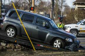 A vehicle is towed away from the scene of a collision at the intersection of Rodd and Carpenter Monday, March 16, 2020 in Midland. (Katy Kildee/kkildee@mdn.net)