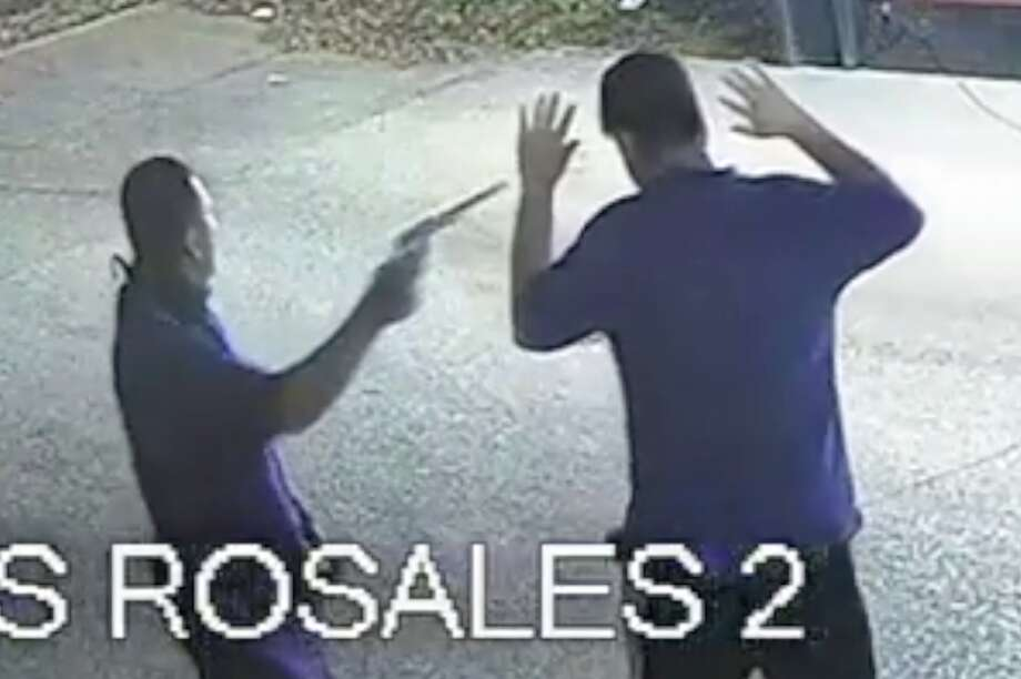 Two men are seen robbing patrons of a taco truck in the 6300 block of Ashcroft on March 3, 2020. Anyone with information is urged to call Houston Crime Stoppers at 713-222-TIPS (8477). Photo: Houston Police Department