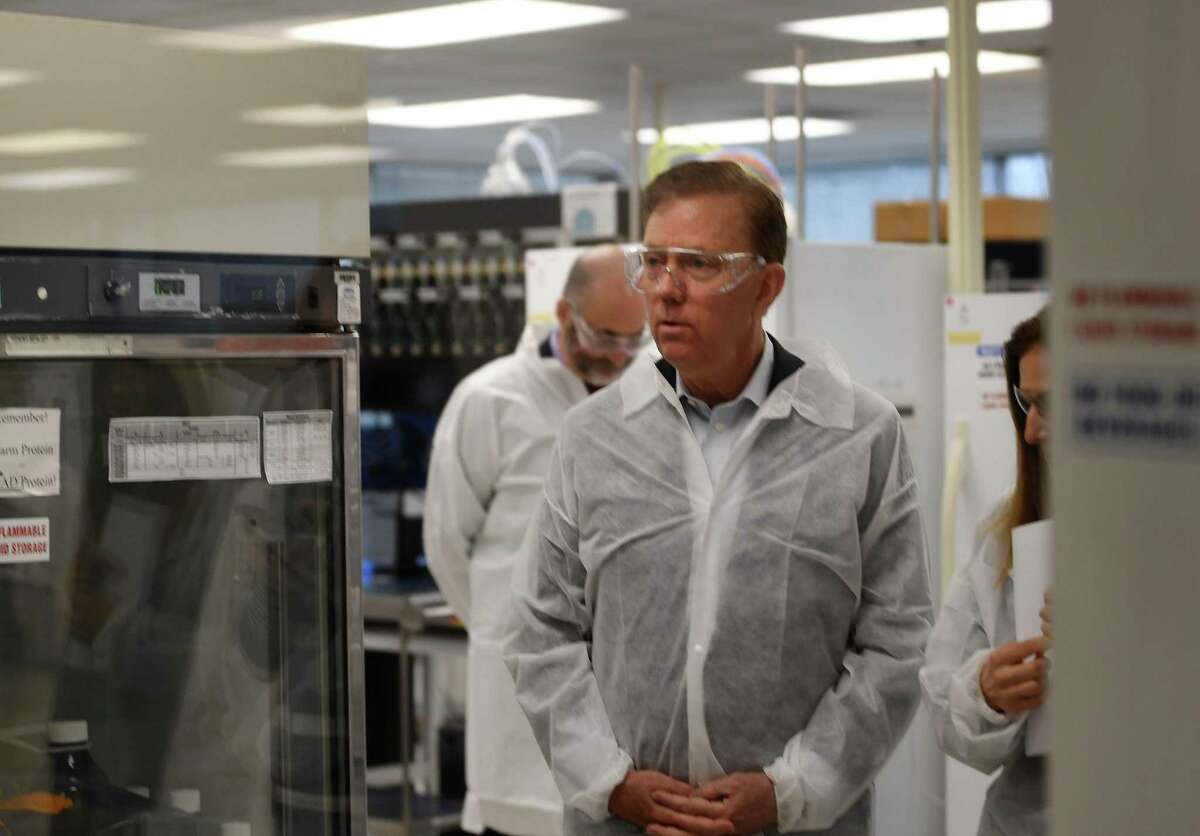 Gov. Ned Lamont and Lt. Gov. Susan Bysiewicz tour the lab at Protein Sciences Corp. in Meriden on Thursday. The company is working on a vaccine for the coronavirus.