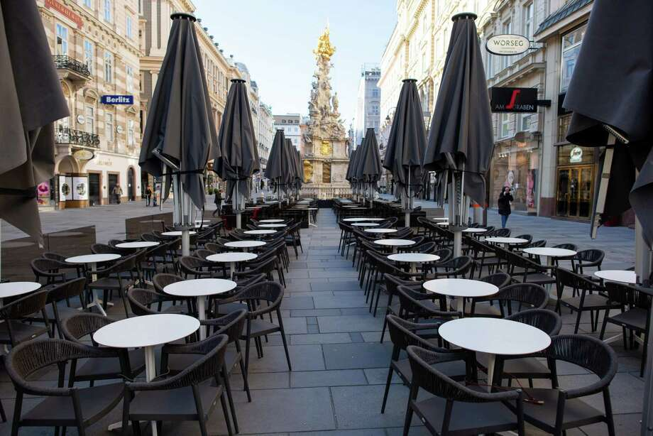 VIENNA, AUSTRIA - MARCH 16: A general view of the empty outside seating area at the Segafredo cafe following the cafe's 3pm closure as part of restrictions imposed by the Austrian government to stem the spread of the coronavirus on March 16, 2020 in Vienna, Austria. Across Austria restaurants, cafes, movie theatres, non-essential shops and other public venues are closing for the coming weeks. The government is also banning gatherings of more than five people and demanding people stay at home unless they need to venture out for work, to get provisions or to care of others. (Photo by Thomas Kronsteiner/Getty Images) Photo: Thomas Kronsteiner, Staff / Getty Images / 2020 Getty Images