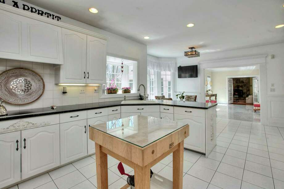 In the chef's eat-in kitchen there are top of the line Bosch appliances, abundant cabinets, and granite counter spaces.