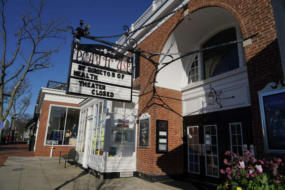 The marquee at the New Canaan Playhouse announces that the movie theater on Elm Street is closed by order of the director of Health, one of many establishments closed to keep people apart in an effort to slow the spread of the Coronavirus. Photo: Grace Duffield / Hearst Connecticut Media / New Canaan Advertiser