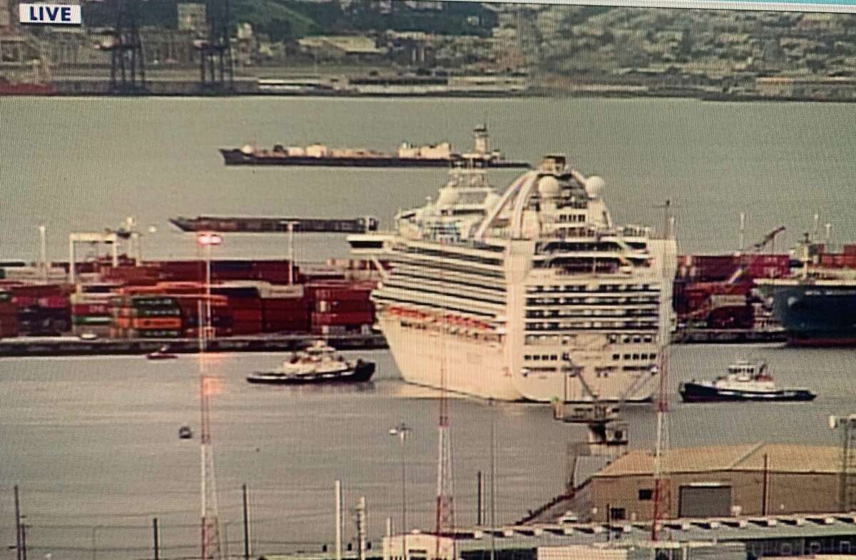 The Grand Princess pushes off from the Port of Oakland early Monday morning, March 16, 2020.
