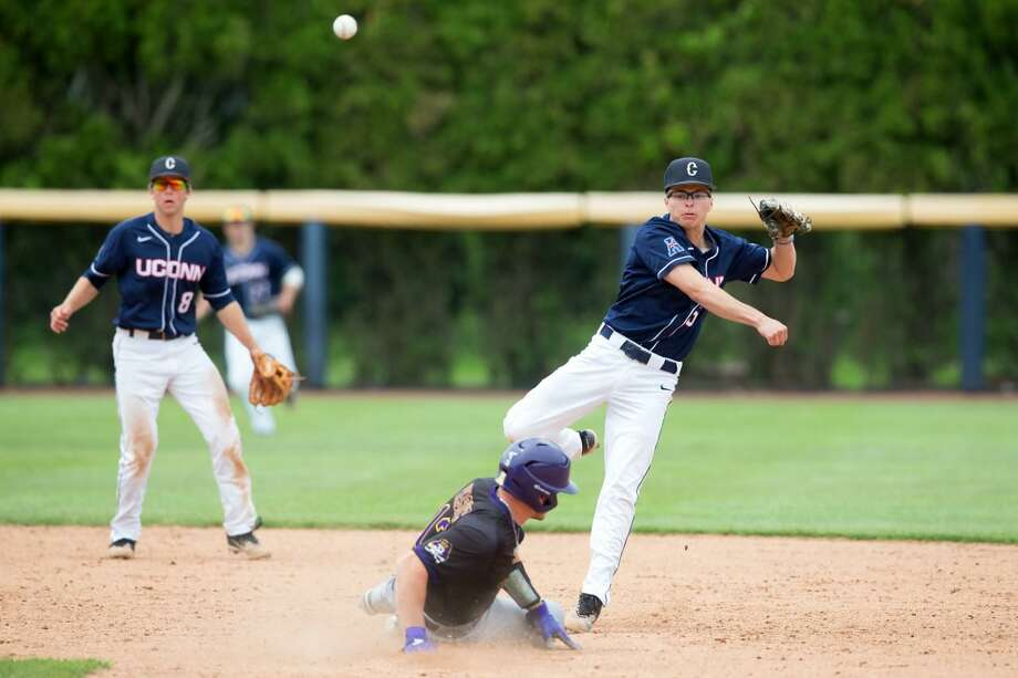 UConn junior infielder Andy Hague turns a double play. Photo: UConn Athletics / Contributed Photo