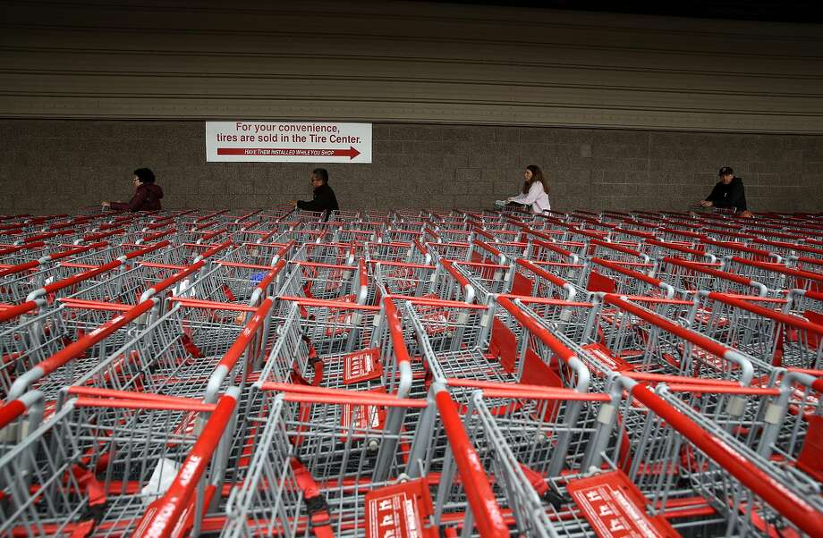 Customers wait in line to enter a Costco store on March 14, 2020. Photo: Justin Sullivan, Getty Images