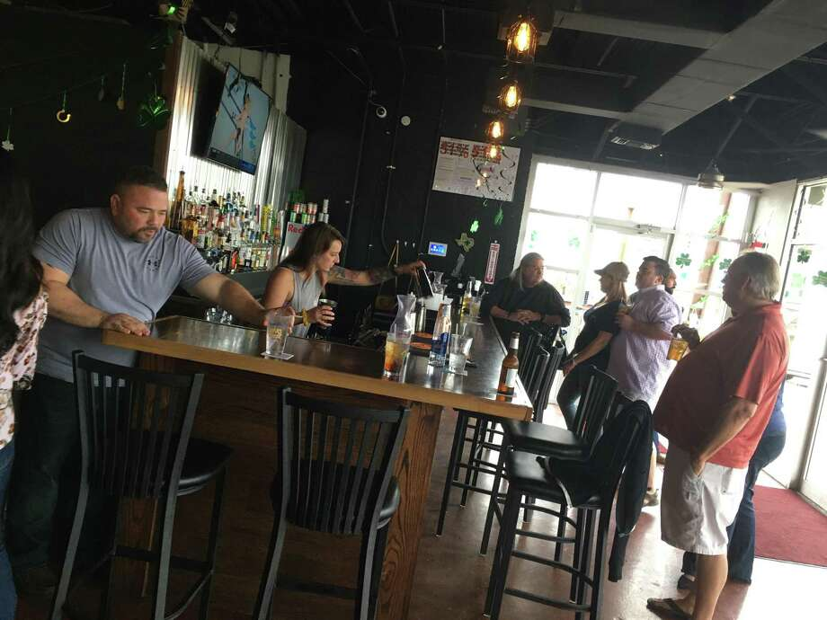 The Fighting Rooster is a new sports bar at 8313 Broadway. Photo: Chuck Blount /Staff