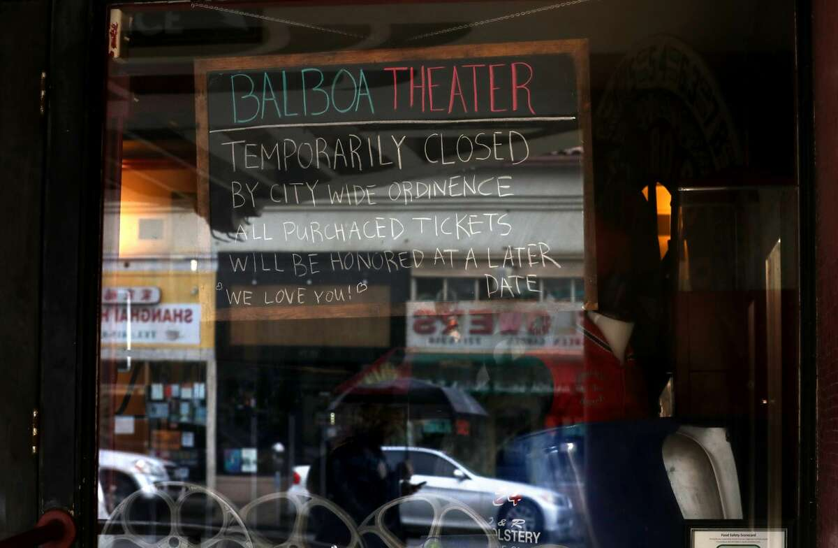 A sign notifies customers of the Balboa Theater that the theater is closed until further notice due to a statewide ordinance banning gatherings of more than 250 people on Mar. 15, 2020 in San Francisco.