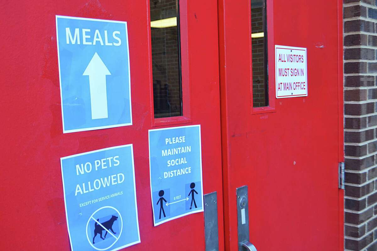 Macdonough Elementary School's food pickup site was open Monday for North End families to take home breakfast and lunch items. They're greeted with several signs explaining precautionary efforts to avoid spreading germs or possibly coronavirus. Playgrounds across Middletown are closed.