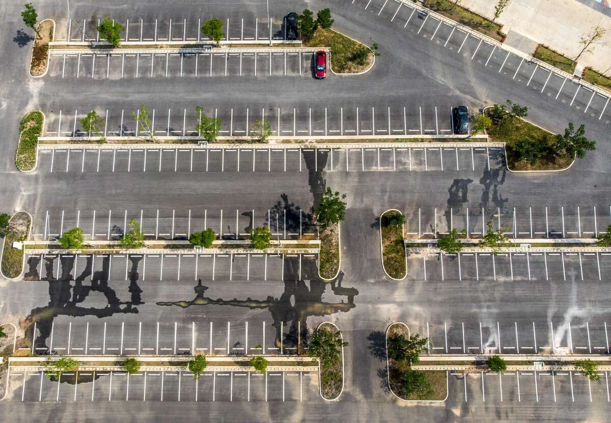 An aerial photo shows the empty parking lot of the Legend Siam theme park in Pattaya on March 8, 2020. - The Legend Siam theme park, which attracts up to 20,000 mainly Chinese customers a day in the high season, is temporarily closed due to the lack of visitors during the COVID-19 coronavirus outbreak. Chinese tourists -- 10 million of whom were expected to visit this year -- have abandoned Thailand, staying at home as a health crisis sweeps the globe, or under quarantine by their government.