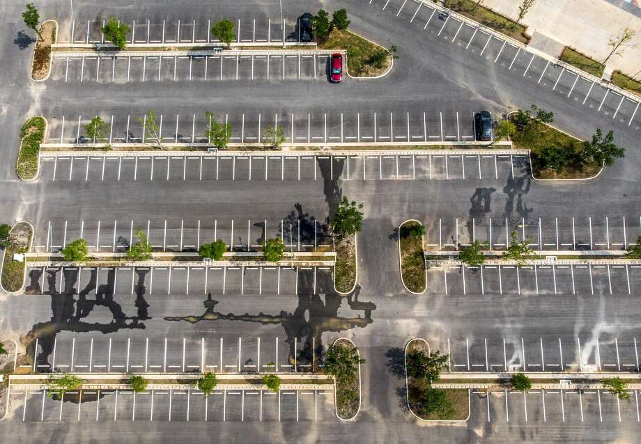 An aerial photo shows the empty parking lot of the Legend Siam theme park in Pattaya on March 8, 2020. - The Legend Siam theme park, which attracts up to 20,000 mainly Chinese customers a day in the high season, is temporarily closed due to the lack of visitors during the COVID-19 coronavirus outbreak. Chinese tourists -- 10 million of whom were expected to visit this year -- have abandoned Thailand, staying at home as a health crisis sweeps the globe, or under quarantine by their government. Photo: Mladen ANTONOV / AFP