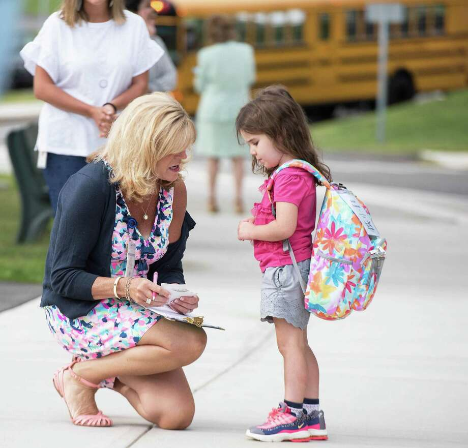 A Connecticut kindergarten teacher speaks to a student. Photo: Bryan Haeffele / Hearst Connecticut Media / Hearst Connecticut Media
