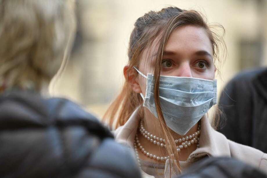 A woman wears a face mask in London, England. Photo: Leon Neal / Getty Images / 2020 Getty Images