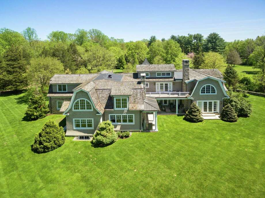 The Nantucket-style colonial house at 289 Fair Oak Road is located at the end of a cul-de-sac on a 2.16-acre property (rear view).