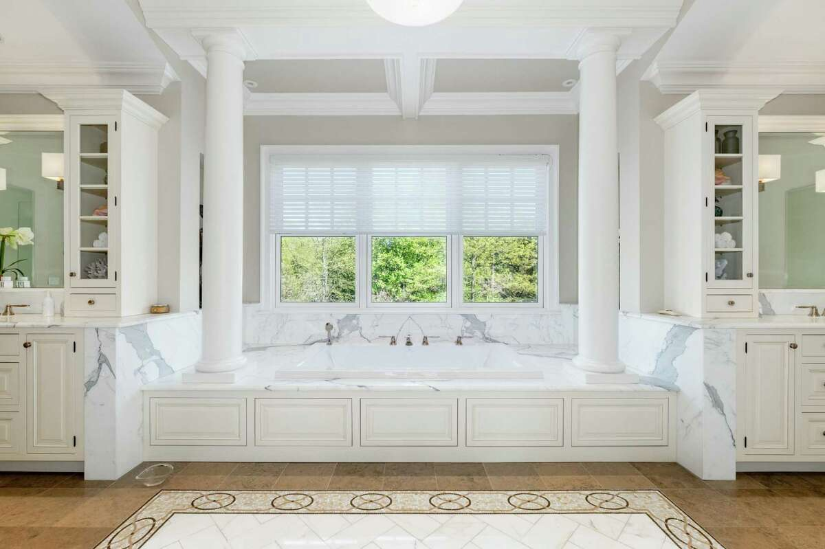 In the indulgent master bath there is radiant heated Calacatta Borghini marble tile flooring, a shower stall, Bain Ultra air jet tub, custom vanities, and water closet.