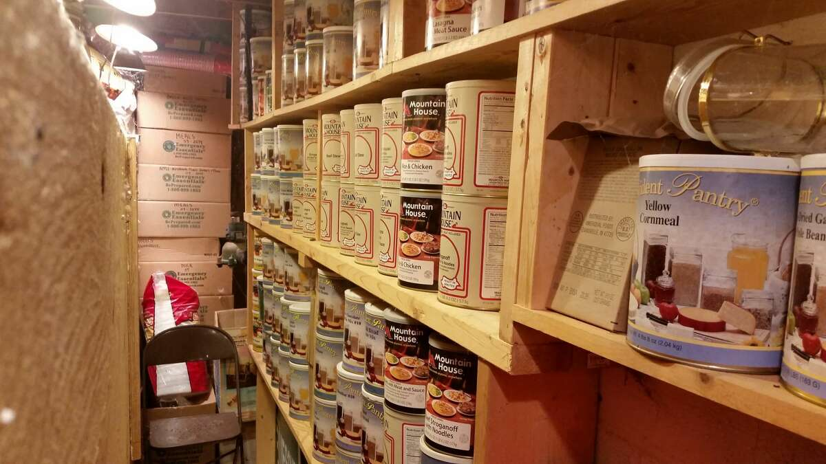 In this undated photo provided by Paul Buescher, canned food rests on shelves in a barn near Garretsville, Ohio. The food can be used by 32 members of a group in northeastern Ohio that shares a farm packed with enough canned and dehydrated food and water to last for years. For those in the often-mocked
