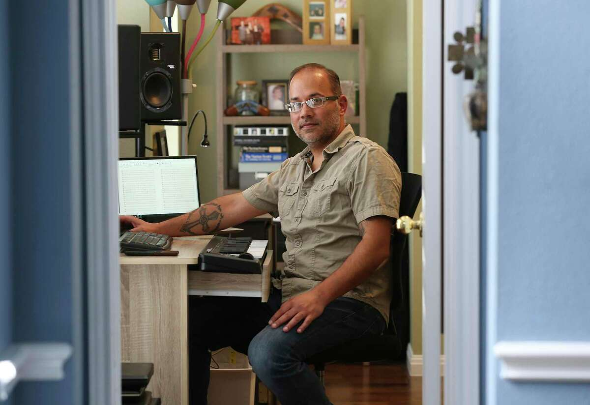 Clarinetist and composer Joe Samuel, 45, sits in the den on Friday, nearing the end of a self-quarantine at his Stone Oak area house. He was in Urbino, Italy, in late February when he got word from UTSA that his three-month trip to study at the Rossini Conservatory of Music in nearby Pesaro would be ended due to the spread of the coronavirus.
