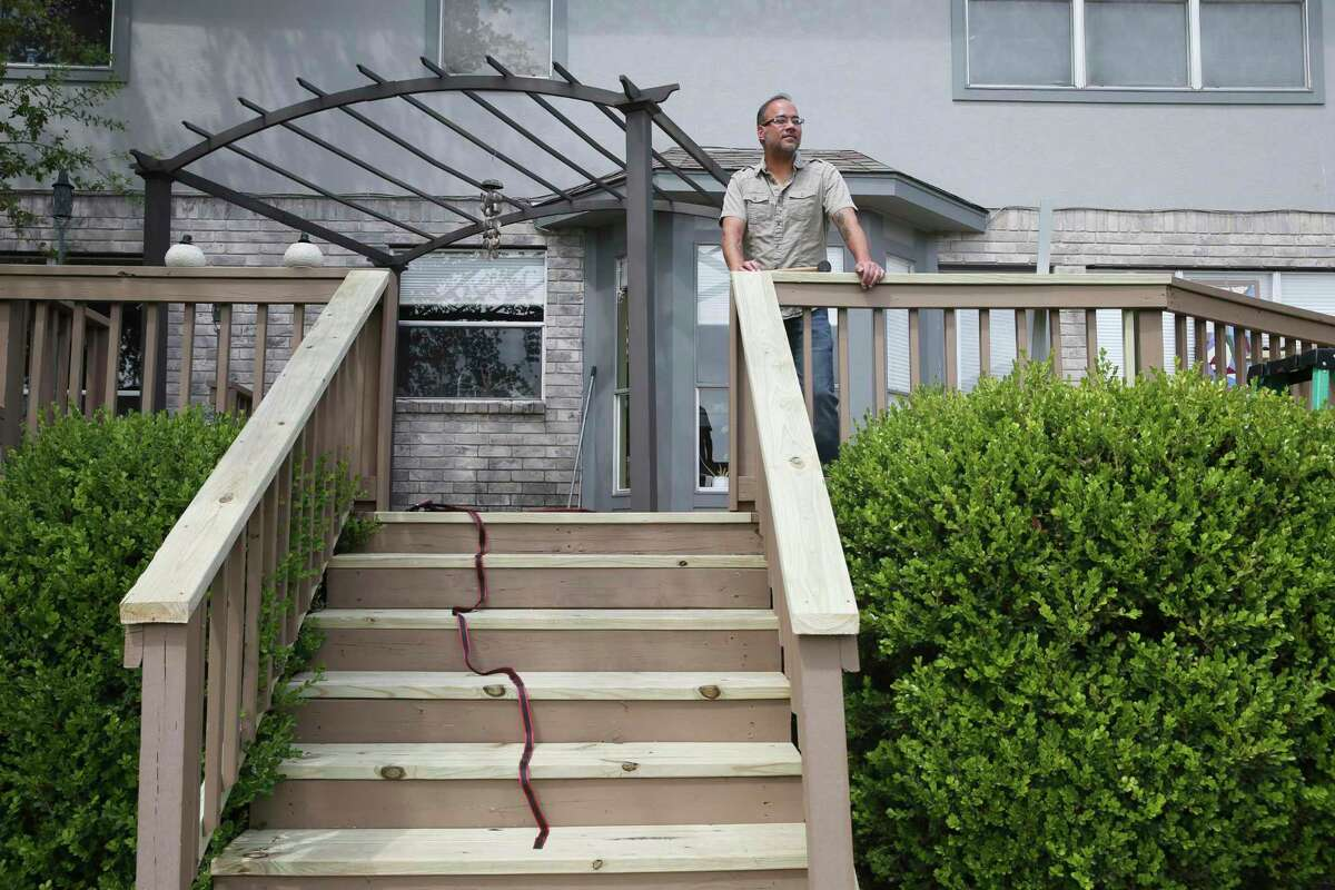 Clarinetist and composer Joe Samuel, 45, looks out from his deck on Friday, nearing the end of a self-quarantine at his Stone Oak area house. He was in Urbino, Italy, in late February when he got word from UTSA that his three-month trip to study at the Rossini Conservatory of Music in nearby Pesaro would be ended due to the spread of the coronavirus.